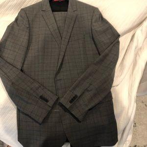 Men's brand new never worn Hugo boss suit
